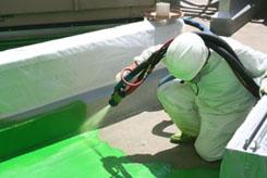man_spraying_product